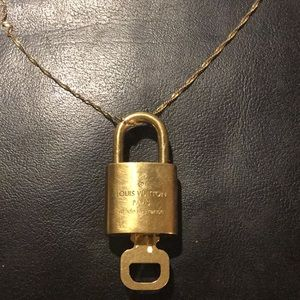 Authentic Louis Vuitton Lock on Gold/ Silver Chain